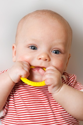 Cute baby with a teething ring