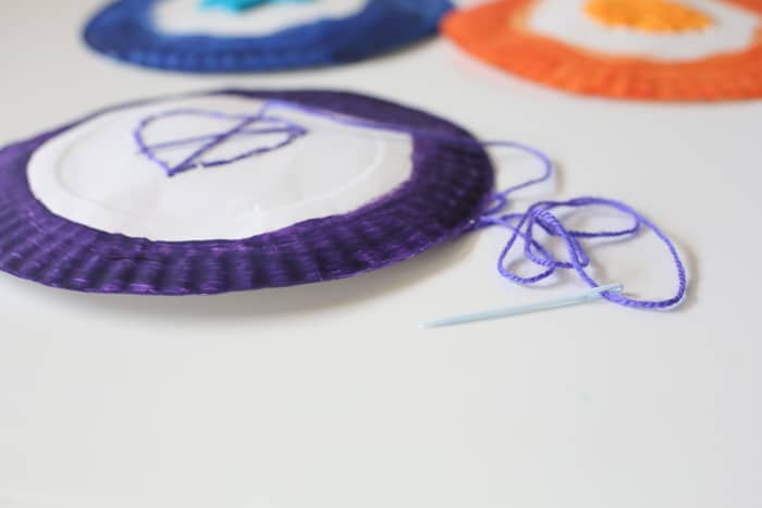 how to help kids learn to sew wit this fun weaving activity