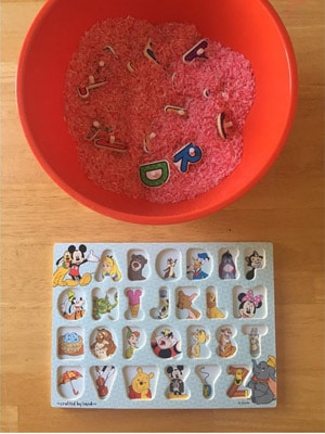 alphabet rice sensory bin puzzle