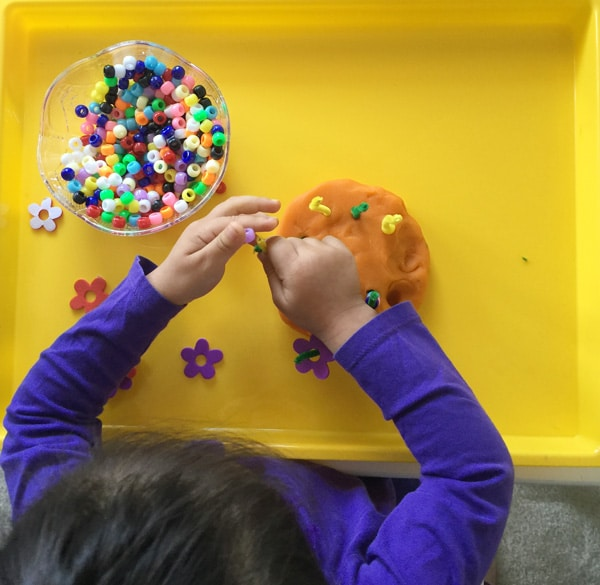 spring is around the corner and this playdough fine motor skills activity is perfect for your toddler or preschool child