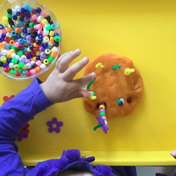 Toddlers love play dough so this fine motor activity is perfect