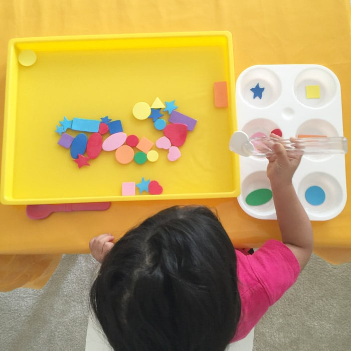 Teaching toddler shapes through water play