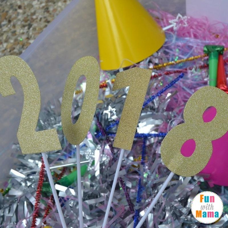 New Year's Eve sensory bin playing 1