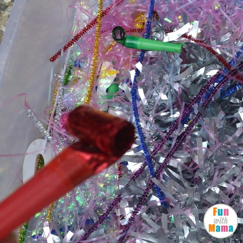 New Year's Eve sensory bin playing 2