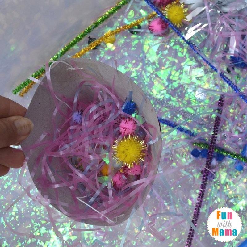 New Year's Eve sensory bin playing 3