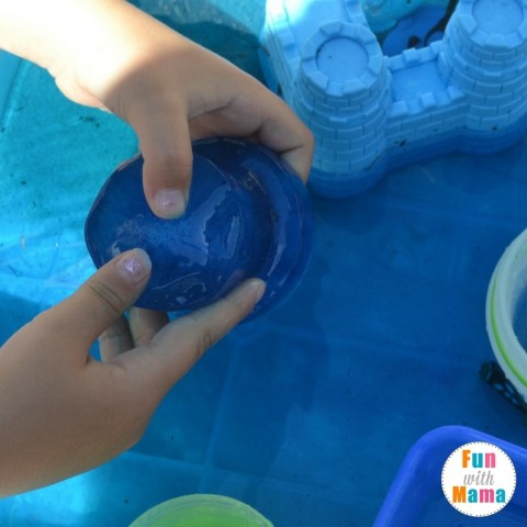 Under the Seas sensory bin playing with ice (Small)