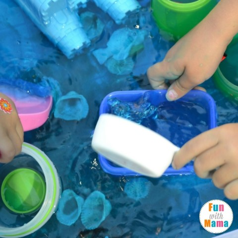Under the sea sensory bin scooping water (Small)
