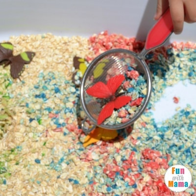 rainbows and butterflies sensory bin scooping