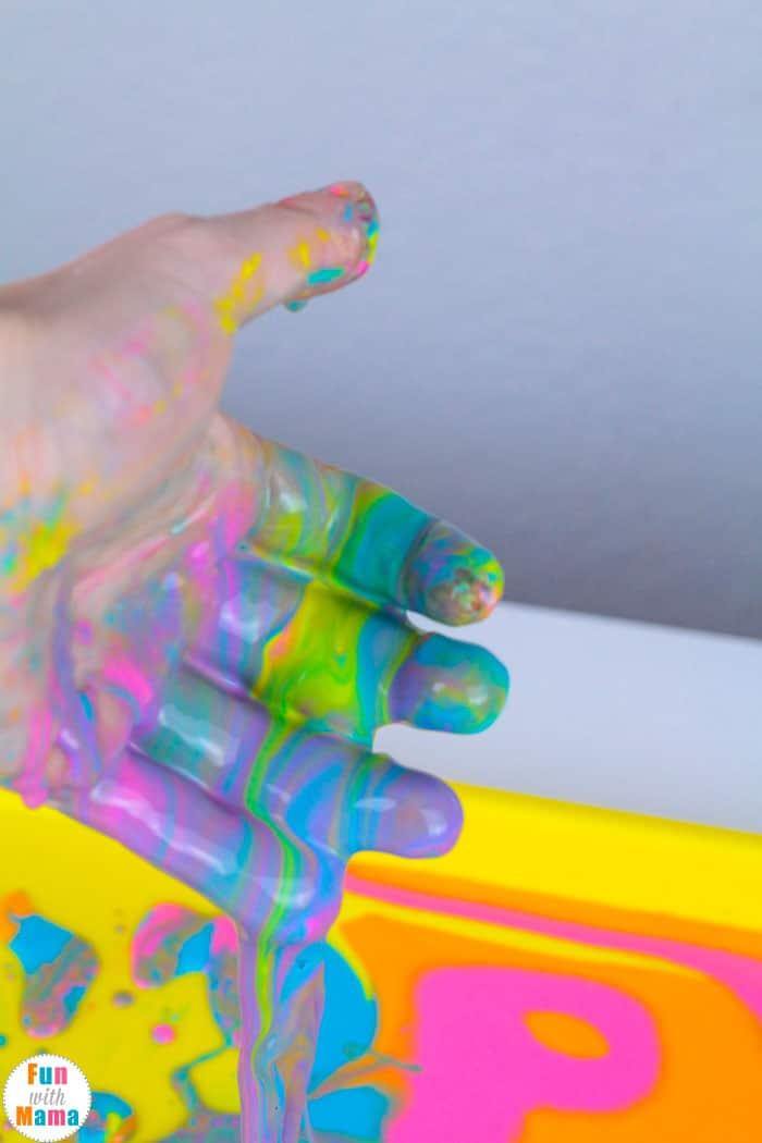 running hands through the Non Newtonian Fluid Oobleck Recipe