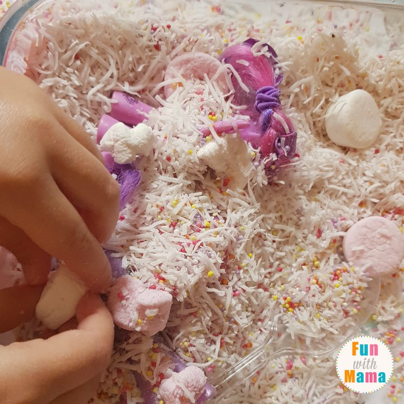unicorn sensory bin playing 2