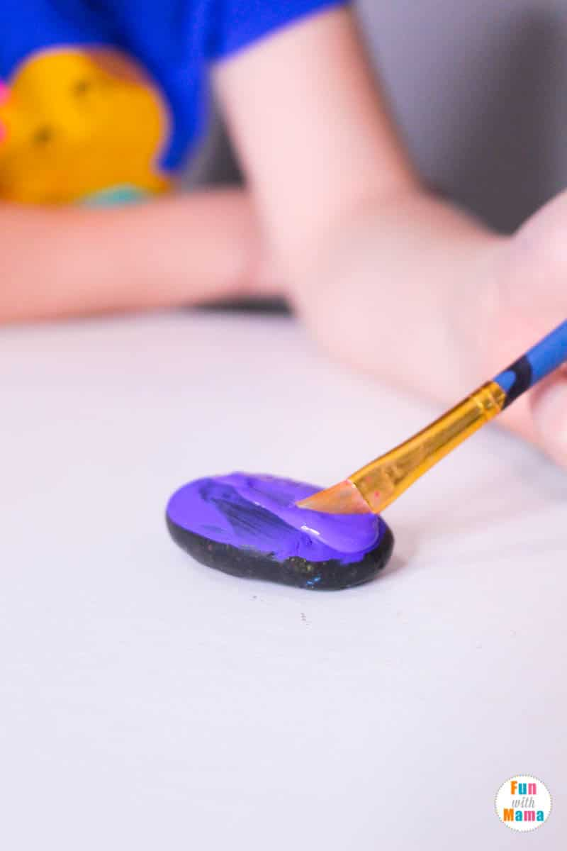 painting on the paint for monster rock painting tutorial