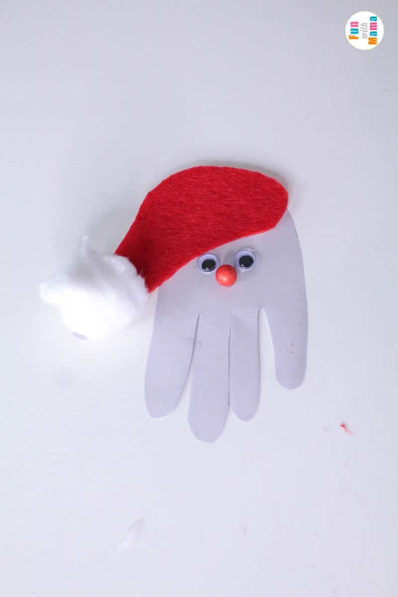 handprint ornament santa craft with a red hat