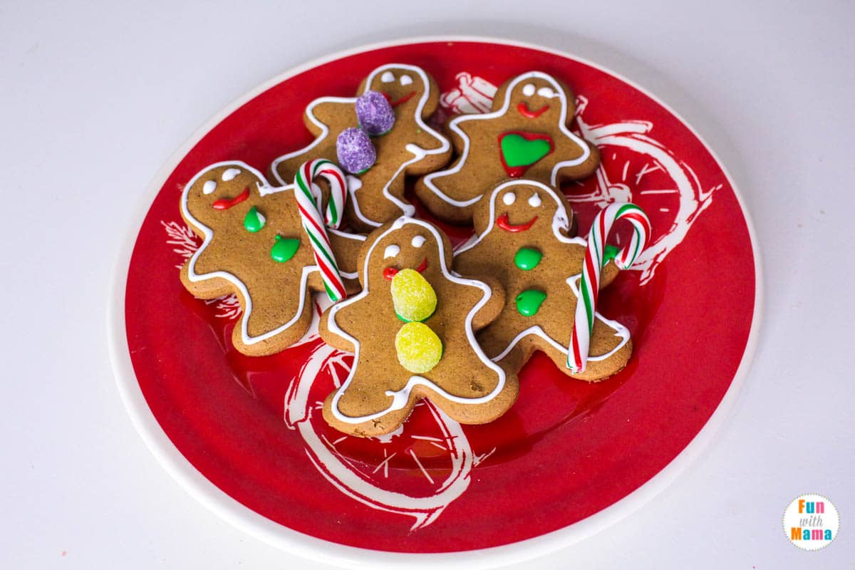 plate full of gingerbread cookies decorated with icing and candy